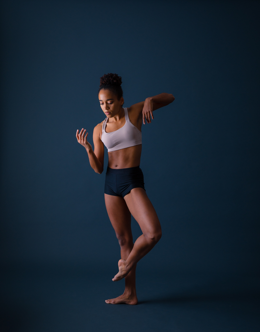 Blue studio portrait of professional ballet dancer Miranda Silveira by Robert Houser in the Bay Area