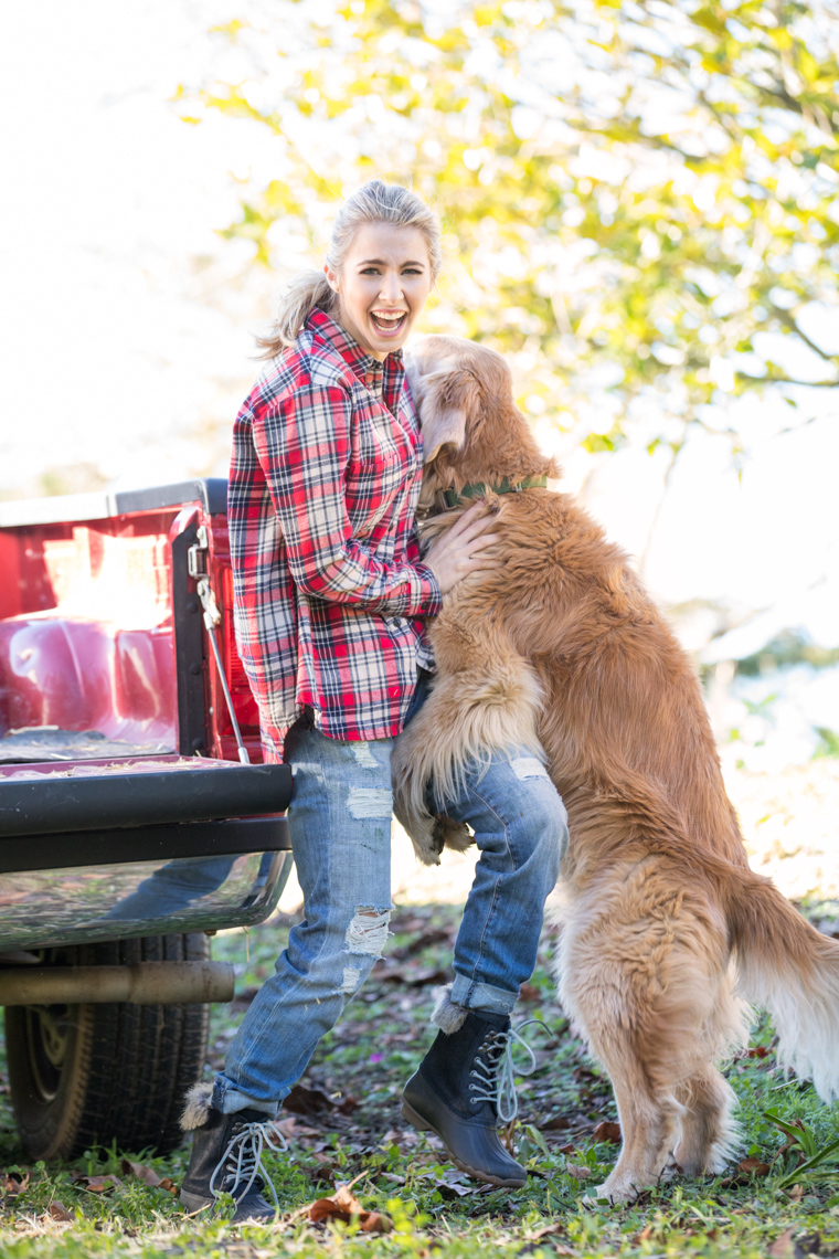 Golden retriever humps the leg of a young woman